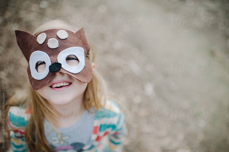young girl smiling with homemade dear mask on by Kristin Rogers Photography for Stocksy United
