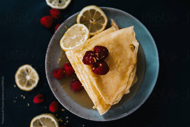 Lemon Cream crepes with raspberries by Treasures & Travels for Stocksy United