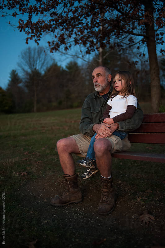Grandfather and little girl talk about the stars after sunset by Brian McEntire for Stocksy United