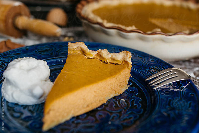 Pumpkin pie slice by Gabriel (Gabi) Bucataru for Stocksy United
