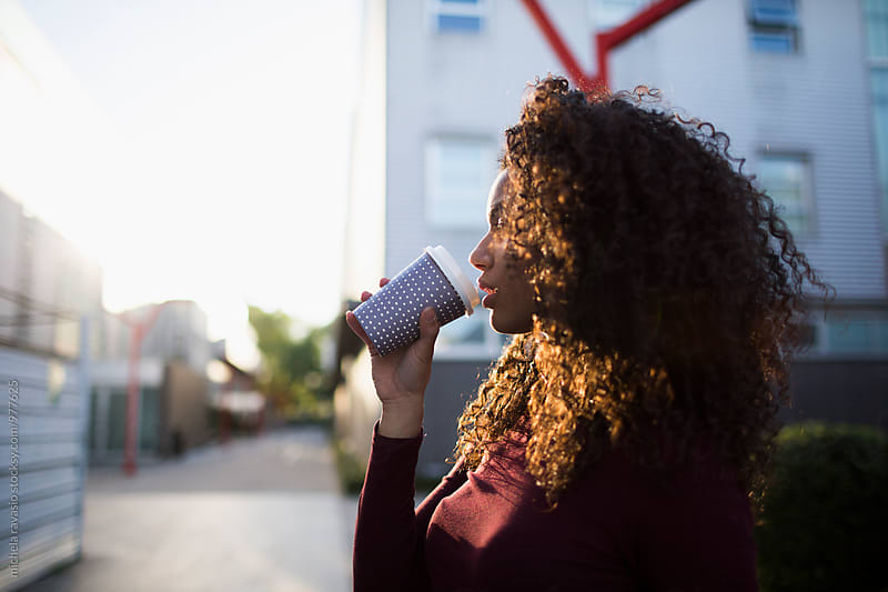 Attractive woman drinking a coffee  by michela ravasio for Stocksy United