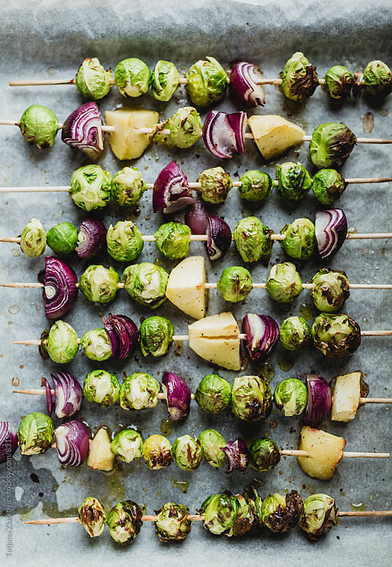 Brussels sprouts with red onion and apple by Tatjana Zlatkovic for Stocksy United