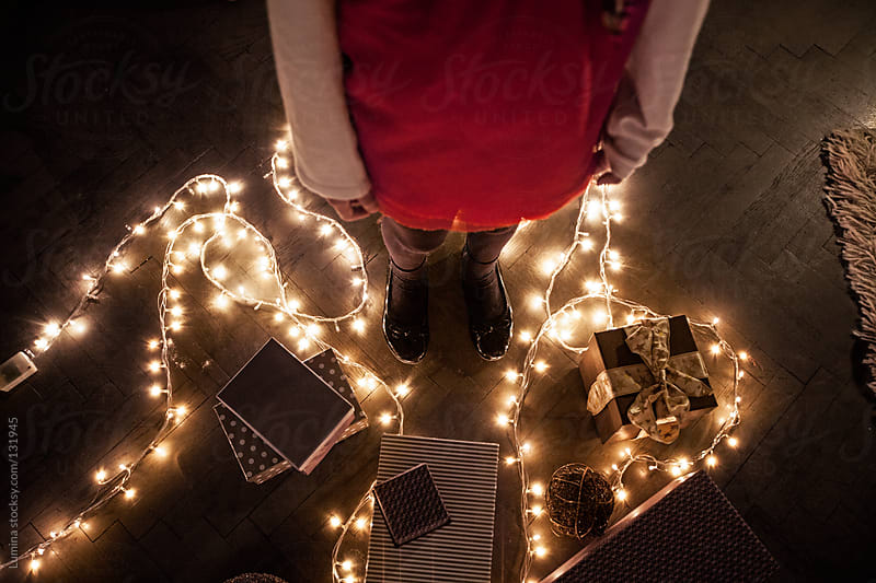Girl and Christmas Presents by Lumina for Stocksy United