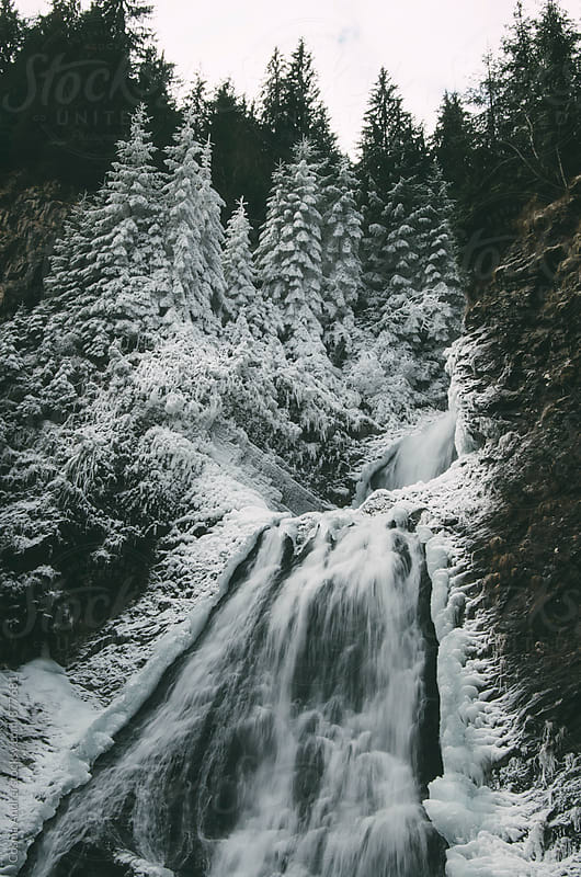 Mountain waterfall in winter by Cosma Andrei for Stocksy United