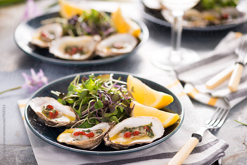 Grilled Oysters with Herb Butter Sauce by Jeff Wasserman for Stocksy United