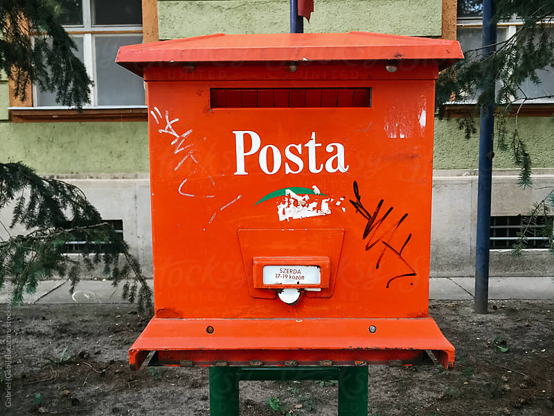 Red post box in Budapest, Hungary by Gabriel (Gabi) Bucataru for Stocksy United