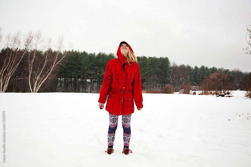 Young Woman Standing In A Field Of Snow by Laura Austin for Stocksy United
