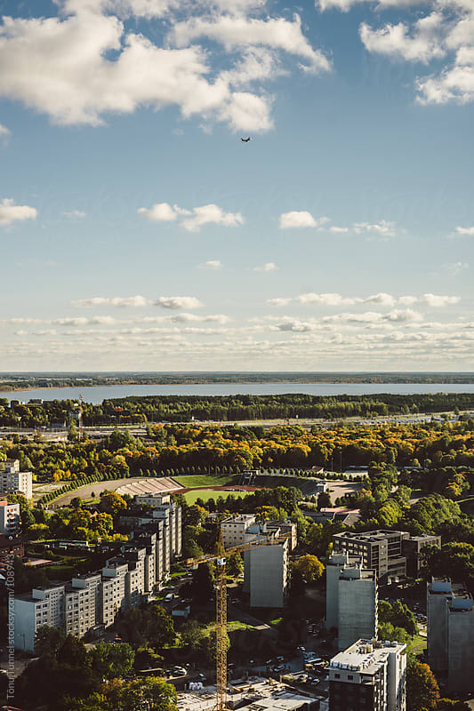 A plane over the city of Tallinn by Tõnu Tunnel for Stocksy United