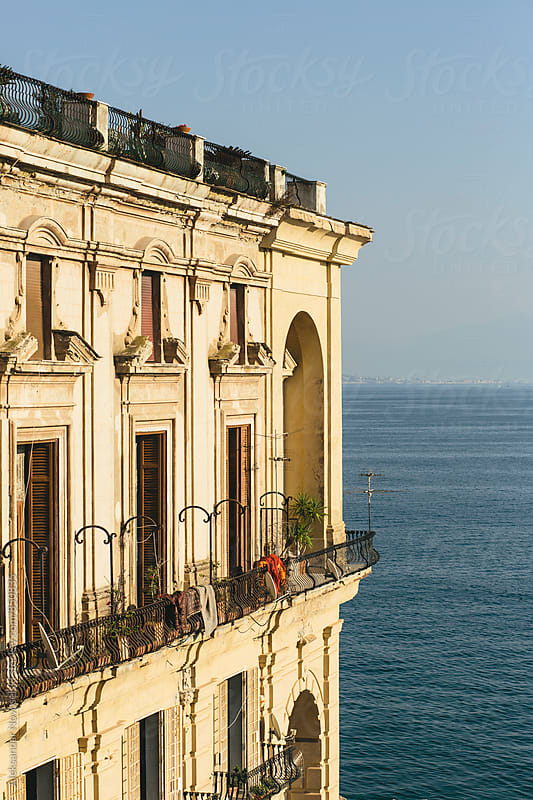 Big mansion by the sea, lit by the sunset in Naples, Italy by Aleksandar Novoselski for Stocksy United