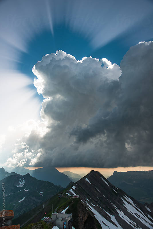 Sunbeams and clouds by Peter Wey for Stocksy United