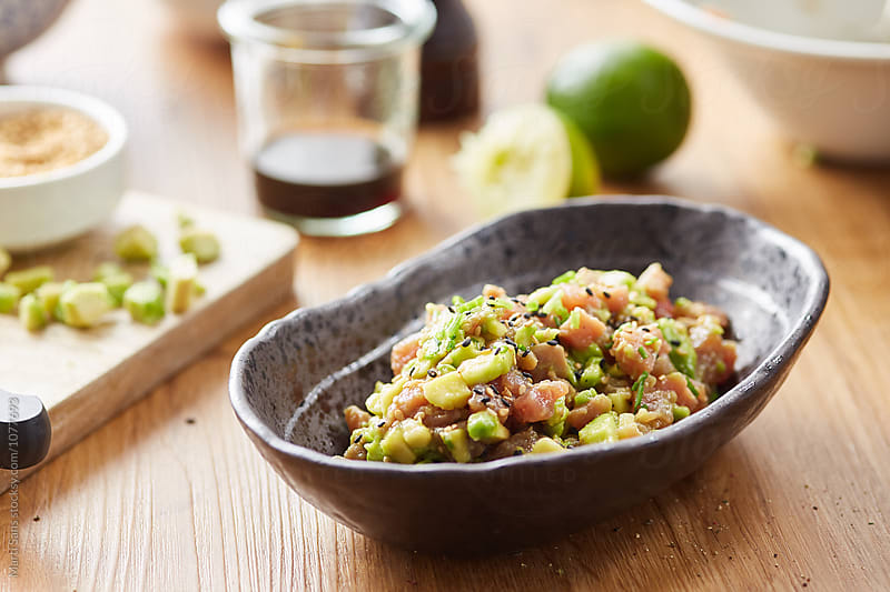 Tasty tartare with tuna,avocado,soy sauce and black sesame by Martí Sans for Stocksy United