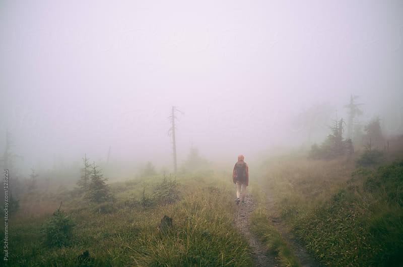 walking throug the fog by Paul Schlemmer for Stocksy United