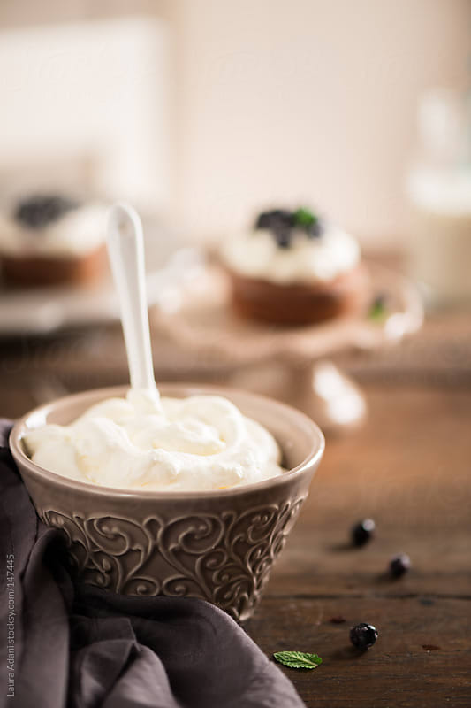 a cup of soft whipped cream by Laura Adani for Stocksy United