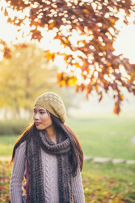 Asian Woman Outdoors in Autumn by Lumina for Stocksy United