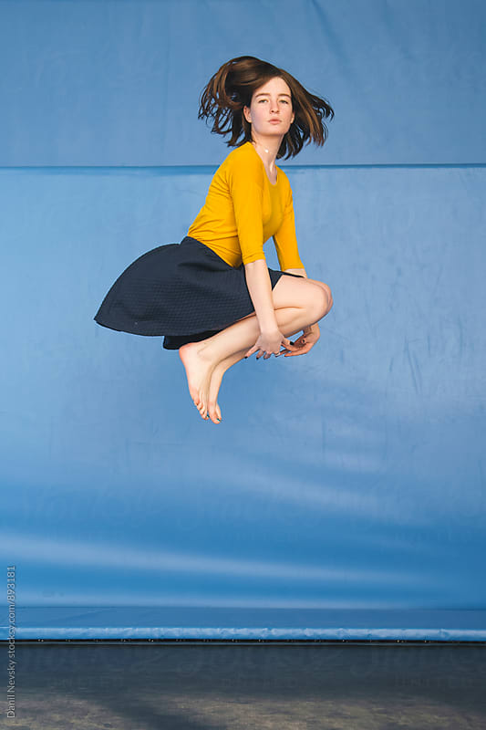 Portrait of young woman jumping on trampoline by Danil Nevsky for Stocksy United