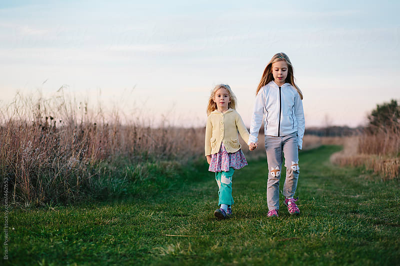 two young sisters in the country  by Brian Powell for Stocksy United