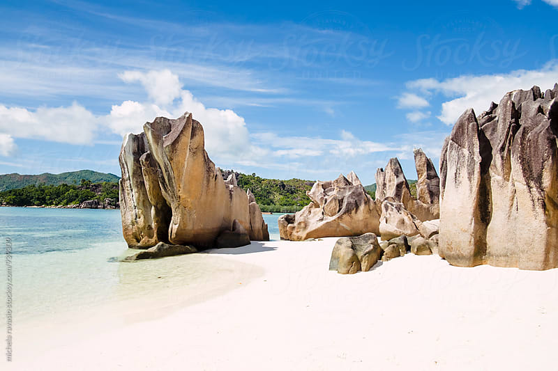 Beach with granite rock formations typical of the Seychelles by michela ravasio for Stocksy United
