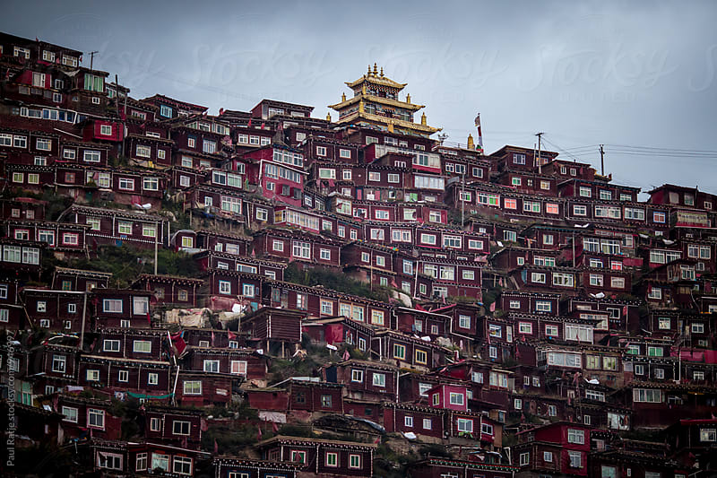 Low view of Sertar Larung Gar Buddhist Academy by Paul Ratje for Stocksy United