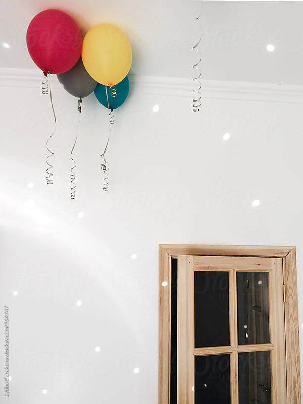 Balloons in a room  by Lyuba Burakova for Stocksy United