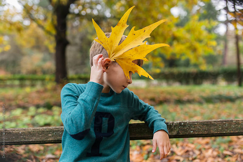 Boy in autumn park. by Dejan Ristovski for Stocksy United