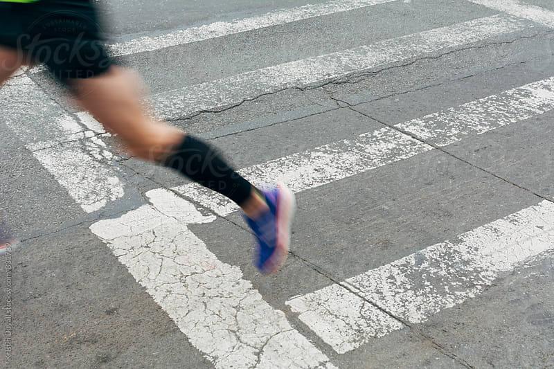 Blurred detail of runner by Kristin Duvall for Stocksy United