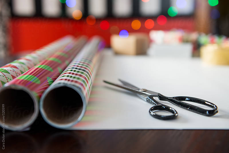 Wrapping paper and scissors for Christmas gifts by Cara Dolan for Stocksy United