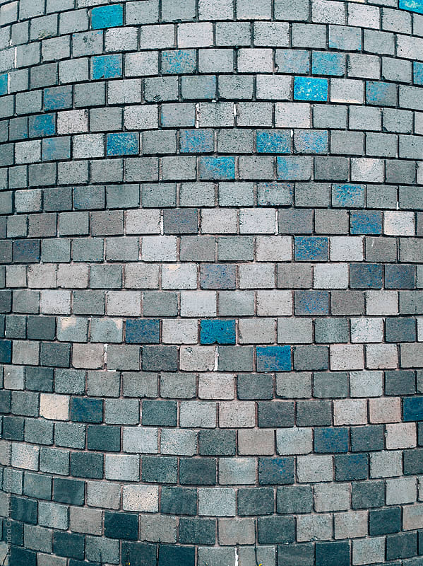 Blue brick round wall by Leandro Crespi for Stocksy United