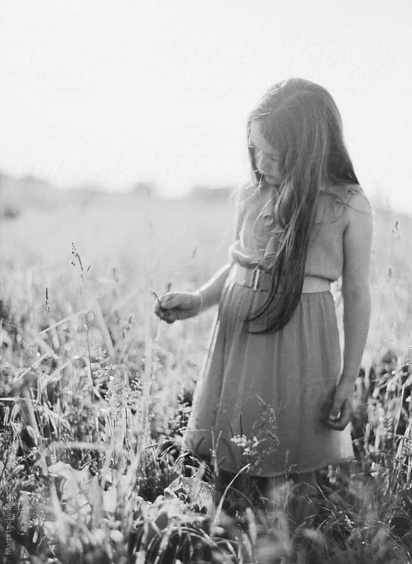 Girl in a field by Marta Locklear for Stocksy United