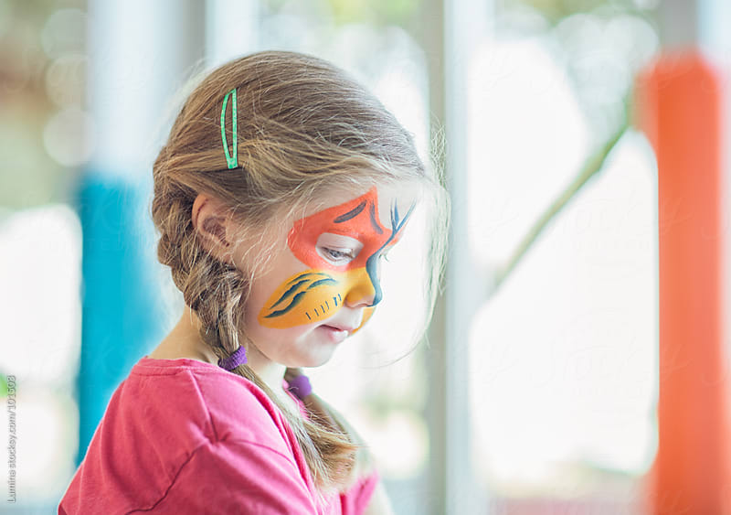 Cute Girl With Painted Face by Lumina for Stocksy United