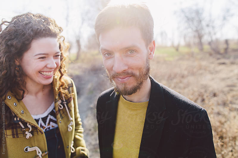 Young funny couple portrait  by Evgenij Yulkin for Stocksy United