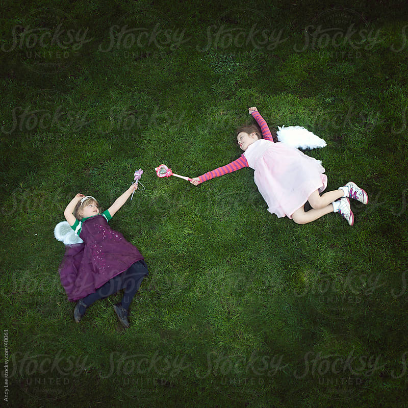 My magnificent girls in their flying machines by Andy Lee for Stocksy United
