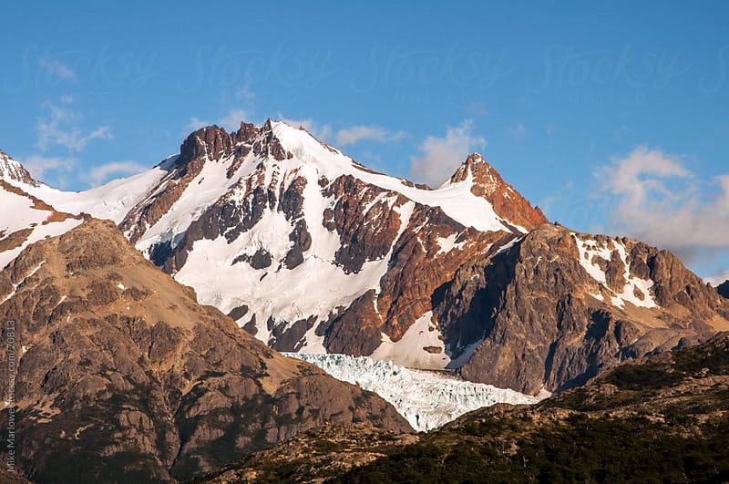 Snow covered granite peaks in Patagonia. by Mike Marlowe for Stocksy United