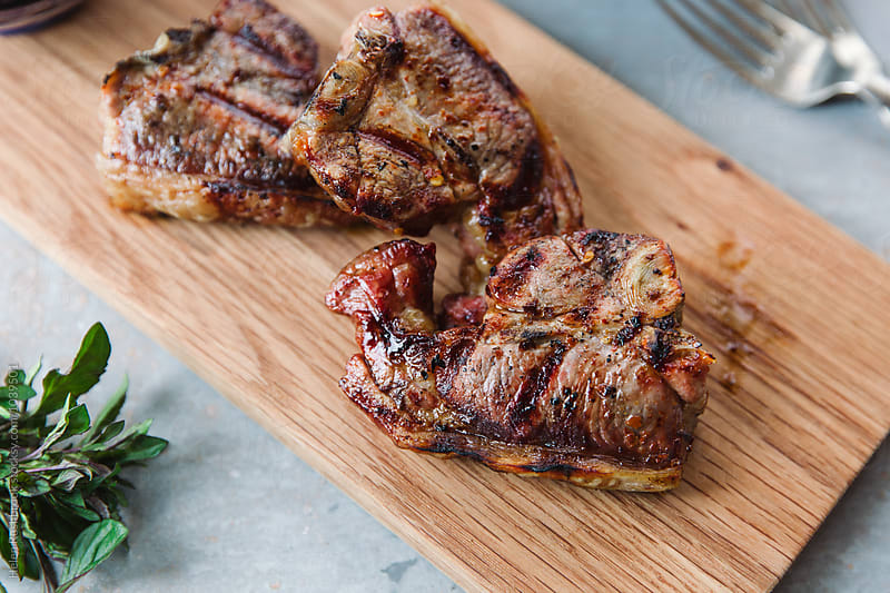 Grilled lamb chops by Helen Rushbrook for Stocksy United