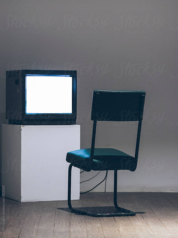 simple furniture,black-and-white television and chair in room by yuanyuan xie for Stocksy United