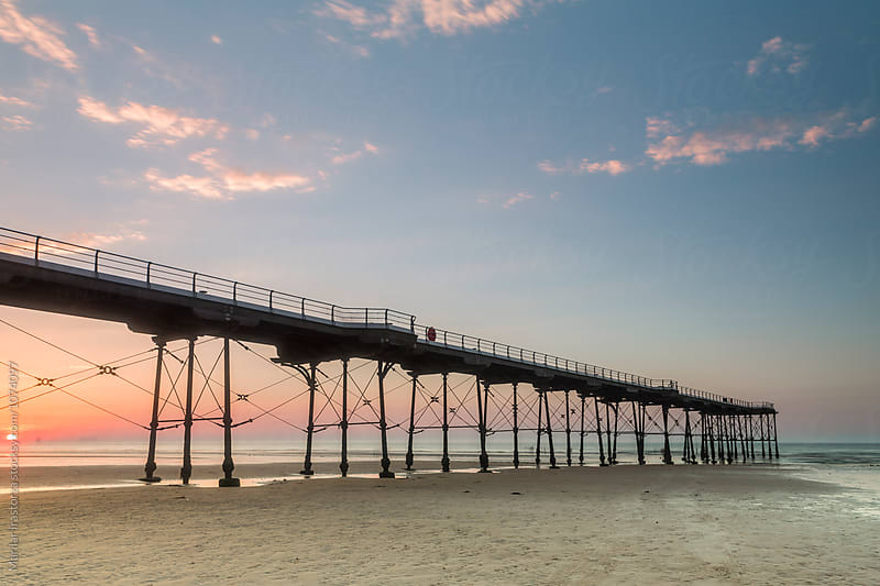 Pier at sunset by Marilar Irastorza for Stocksy United