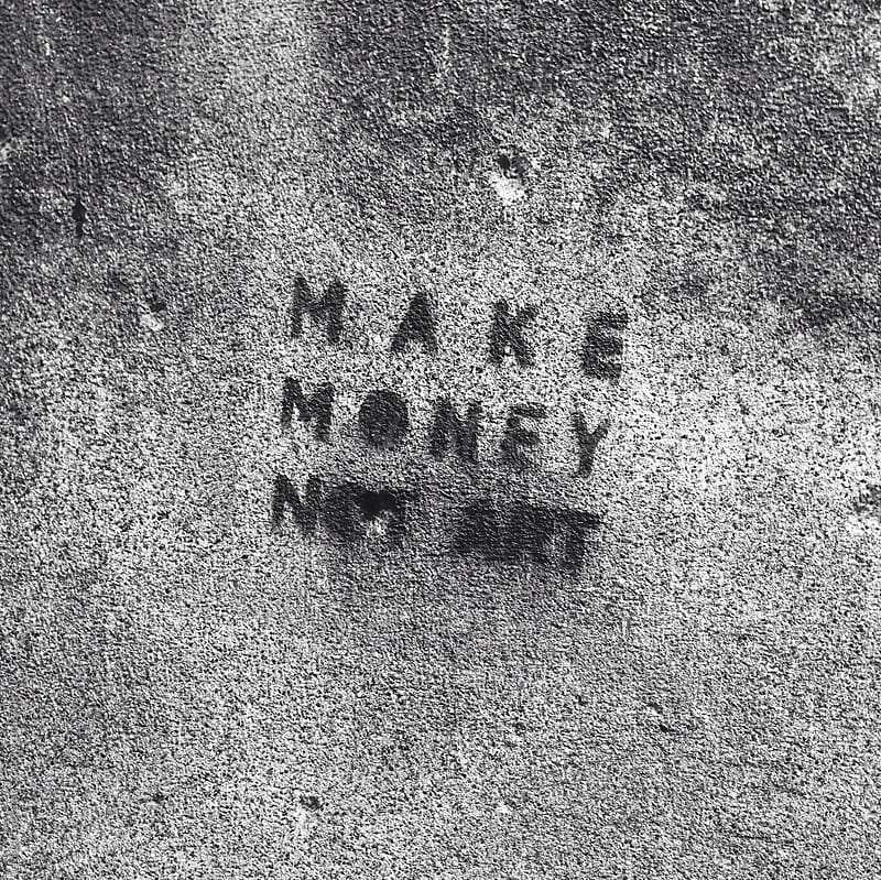 Make money, not art wall graffiti by Maja Topcagic for Stocksy United