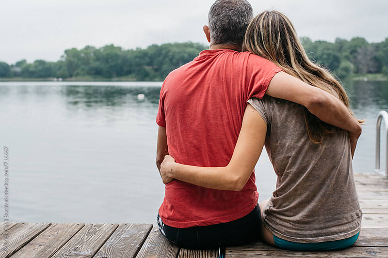 Couple hugging by a lake by Gabriel (Gabi) Bucataru for Stocksy United