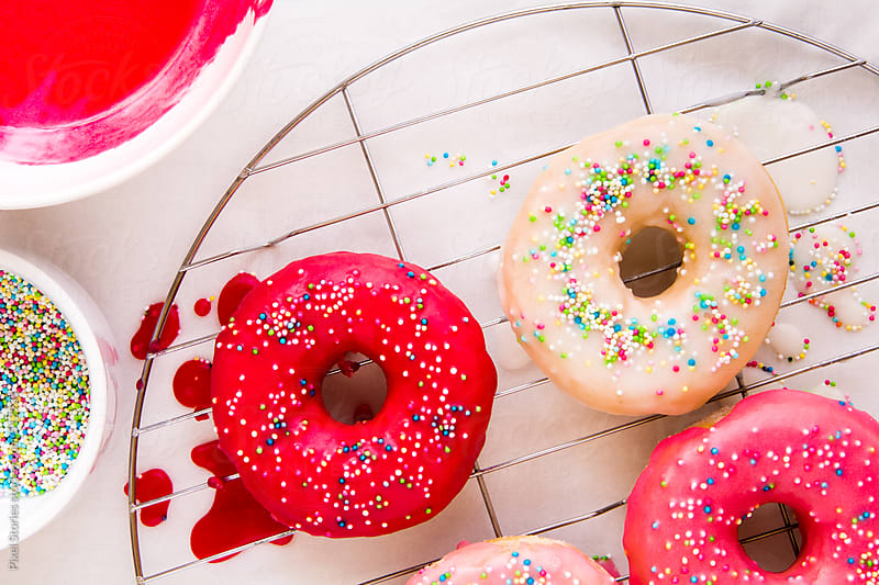 Homemade glazed donuts  by Pixel Stories for Stocksy United