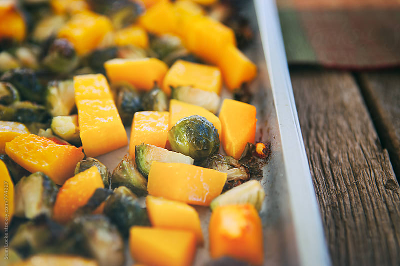 Polenta: Roasted Butternut Squash And Brussles Sprouts In Pan by Sean Locke for Stocksy United