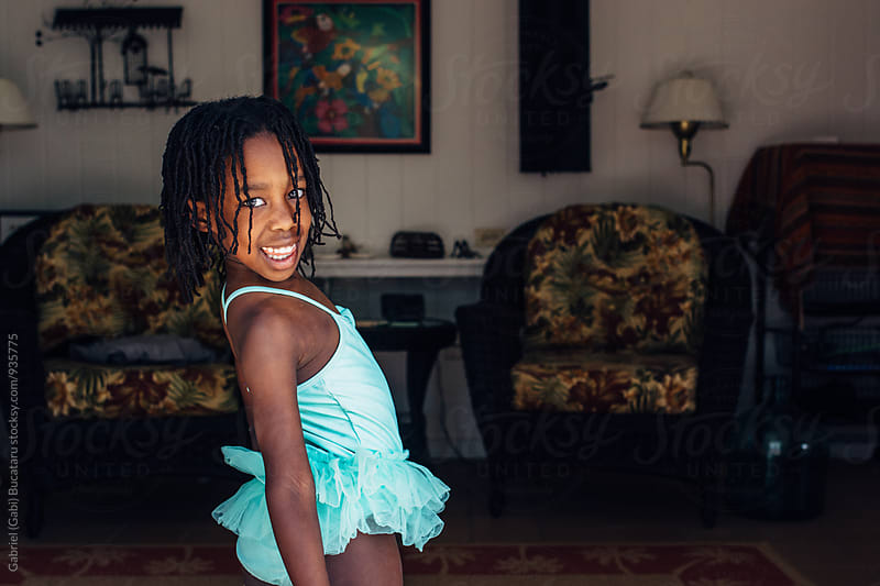 Smiling black girl in a turquoise swimsuit by Gabriel (Gabi) Bucataru for Stocksy United