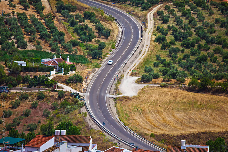 Landscape of Car travelling along winding road in Spain by Rowena Naylor for Stocksy United