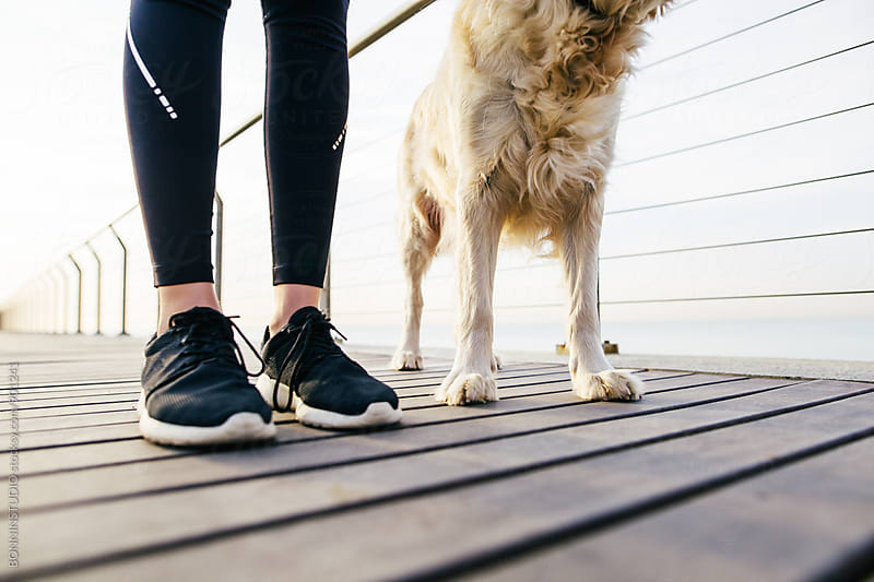 Closeup of a runner woman and her dog. by BONNINSTUDIO for Stocksy United