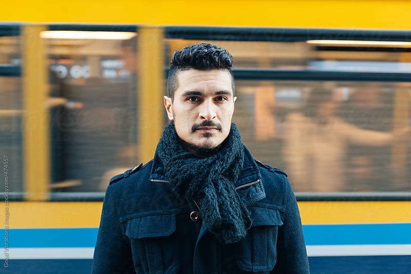 A bus travels behind a serious man by Good Vibrations Images for Stocksy United