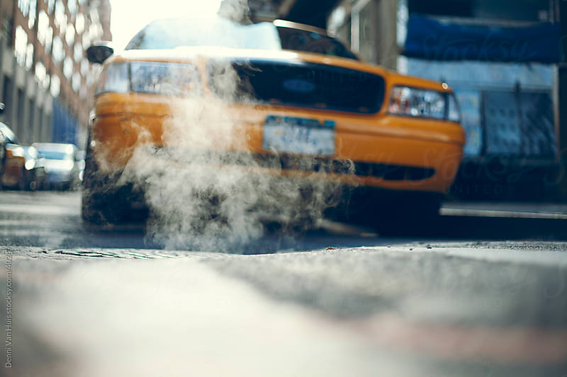 Smoking manhole in the streets of New York by Denni Van Huis for Stocksy United
