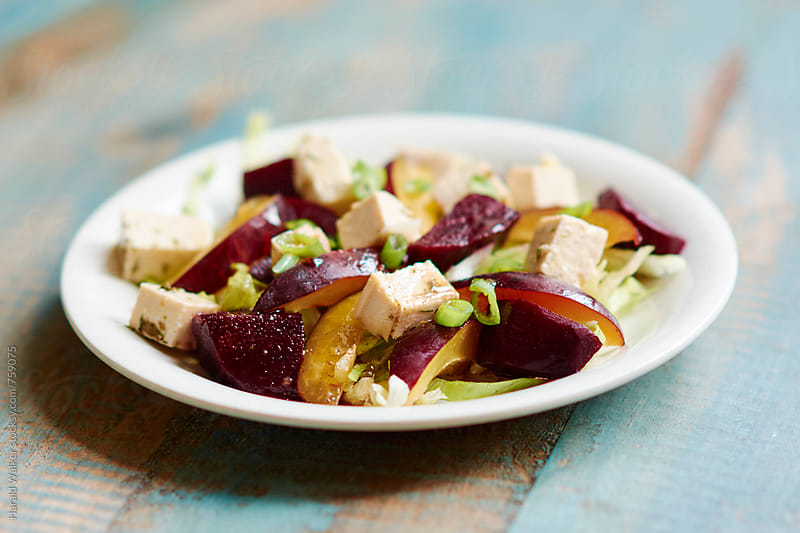 Beets with plums and tofu by Harald Walker for Stocksy United