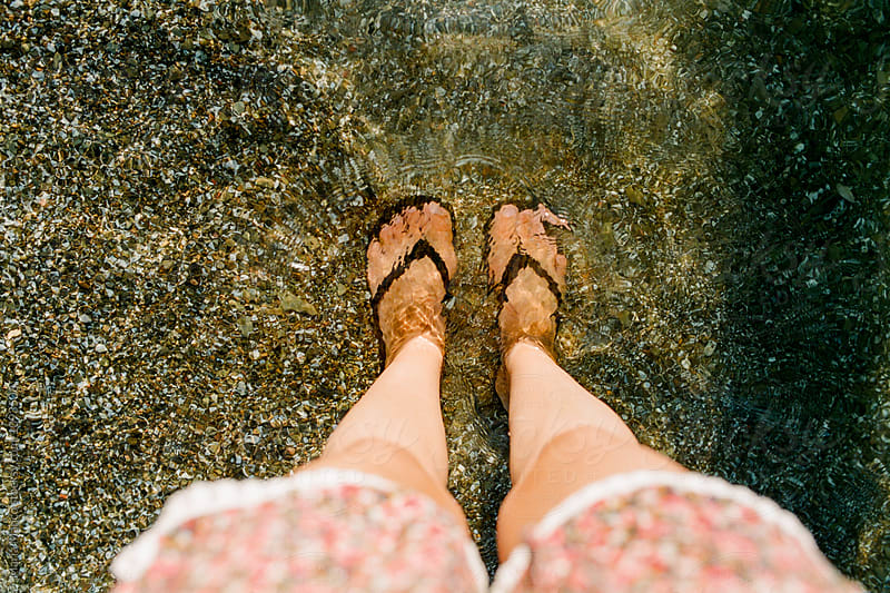 feet in water by Maria Manco for Stocksy United