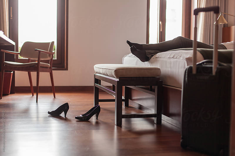 Anonymous Businesswoman Relaxing in a Hotel Room by Mosuno for Stocksy United