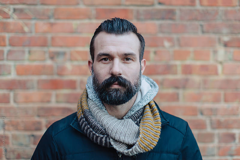 Portrait of a well groomed handsome man with a beard by Jakob for Stocksy United