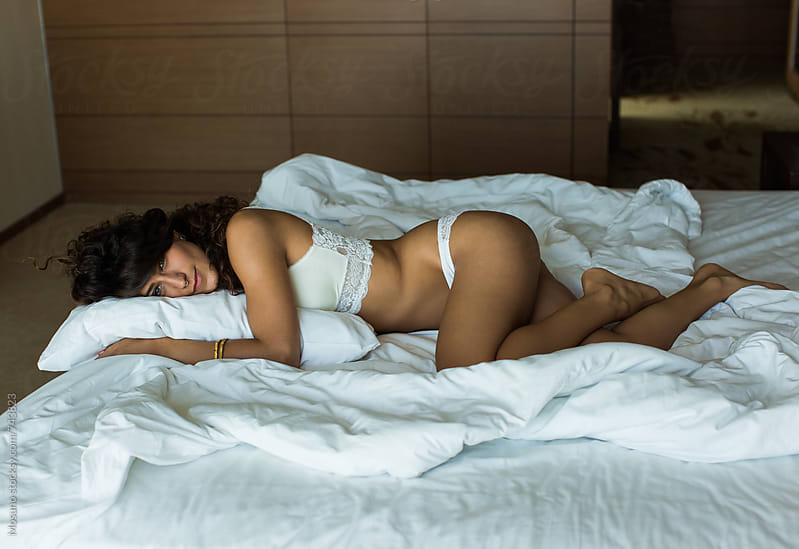 Woman Lying in Bed in the Morning by Mosuno for Stocksy United