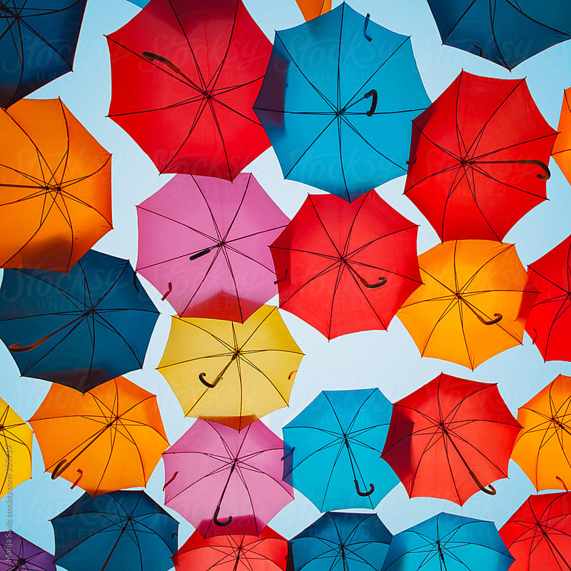 Colourful umbrellas against blue sky. by Marija Savic for Stocksy United
